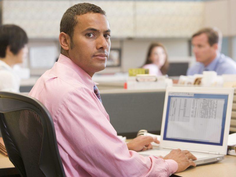 photo of man sitting at computer