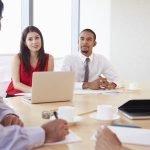 Four Business people Having Meeting In Boardroom