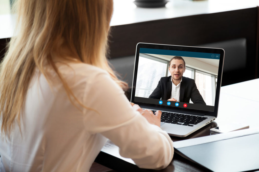 photo of woman on virtual meeting with a coworker
